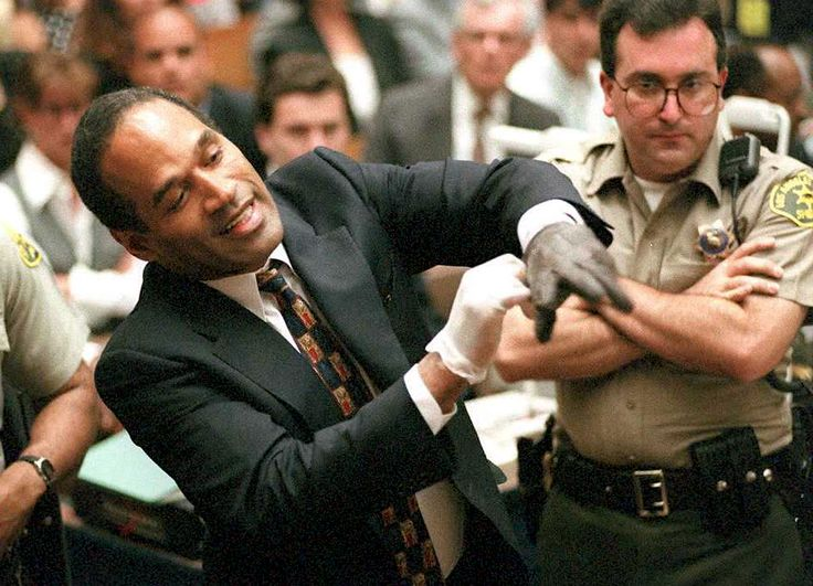 1995 OJ Simpson trying on gloves in court.