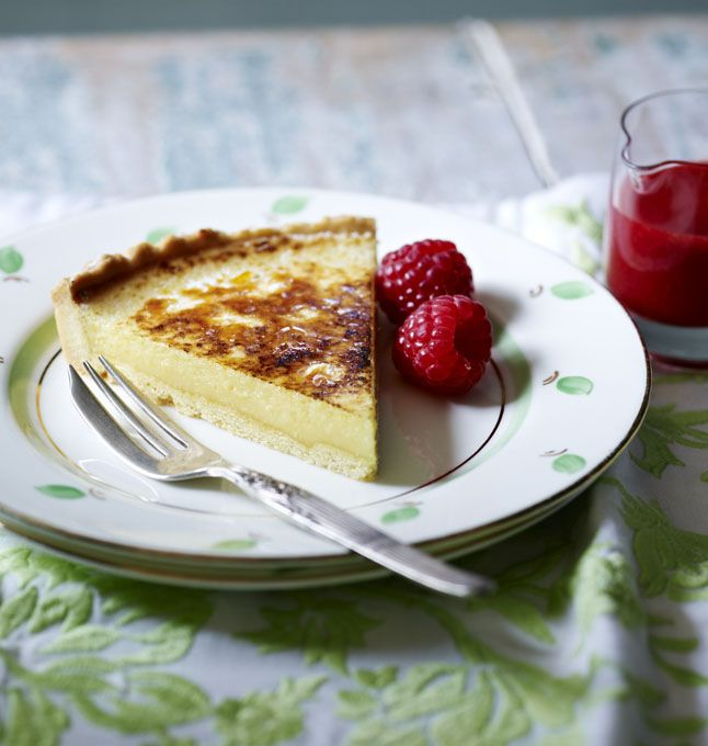 A cool and creamy lemon tart with a with raspberry champagne sauce. It can be prepared ahead of time too