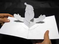Free Santa pop-up card template. This and many more free pop-up card templates are available on this site.
