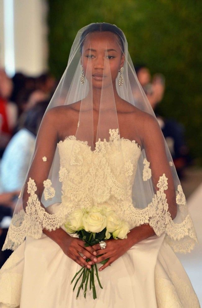White wedding dress by Oscar de la Renta, included the wedding veil