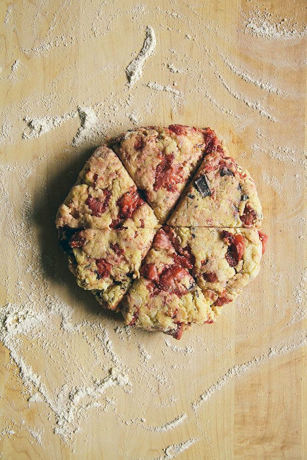 Place the dough on a well-floured surface, and shape it into a rough circle. Divide into six triangles, sprinkle with sugar, then pop everything into the oven.