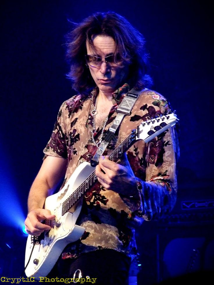 Steve Vai and his famous Ibanez Jem 7v guitar with his signature built in handle.