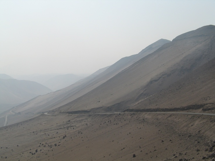 Highway 11 inland from Arica climbs the 5000 ft dust mountains of the driest place on earth:  The Atacama Desert, Chile.