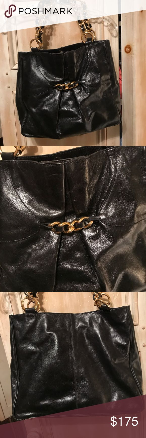 Doncaster designer handbag from Italy This is a brand-new handbag made by Doncaster that is a $400 handbag made in Italy of Italian leather Has thick gold chain and leather straps. Doncaster Other