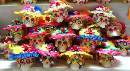 Mounds of fabulously decorated sugar skulls are on display for competition and sale at the Feria de Alfinique in Toluca before Day of the Dead. Over 150 local artisan families exhibit the traditional candy traditions of Mexico.