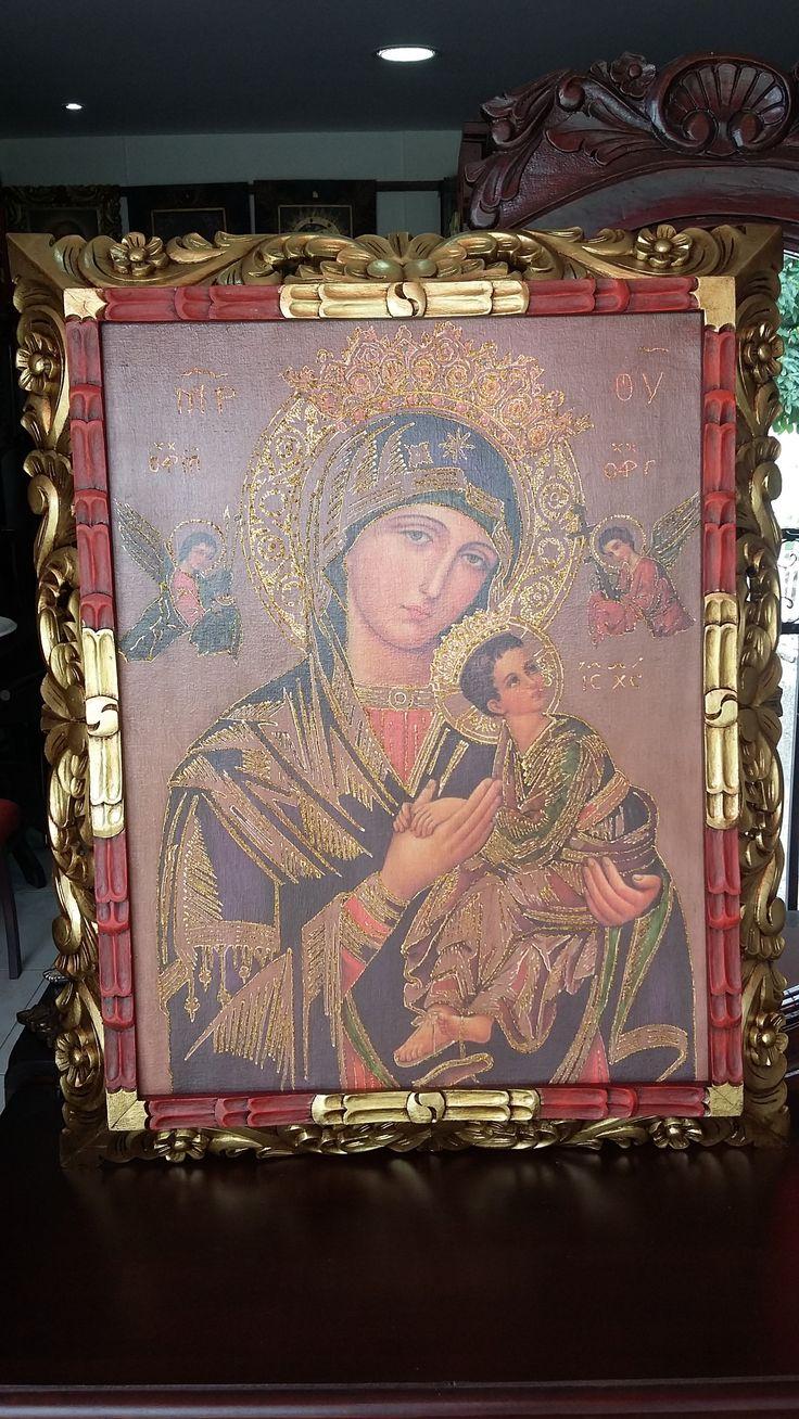 Virgen del perpetuo Socorro. Marco talla en madera. Lámina iluminada.