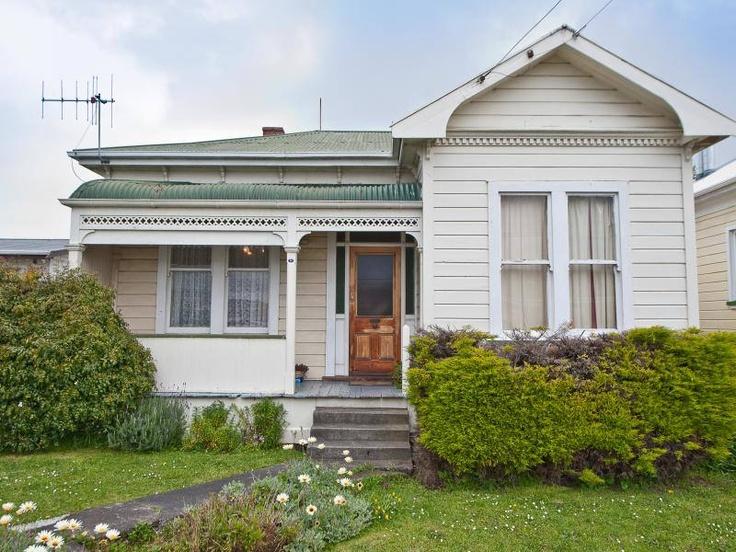 love the flat fronted villa, and the bullnosed verandah roof. Wanganui, New Zealand