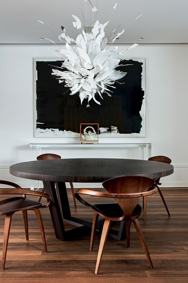 Black dining room table, wood chairs and modern white chandelier | Zize Zink Interiors