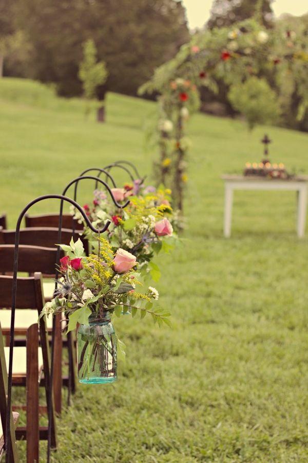Shepherd's hooks + mason jars + flowers.