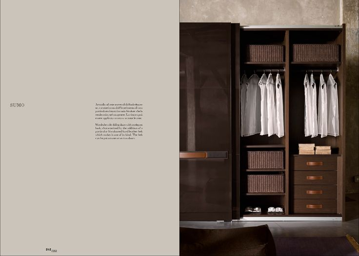 Wardrobe with sliding doors with an elegant look, characterized by the addition of a particular bi-coloured hard leather belt which makes it one of its kind. The belt can be put on one or on two doors.