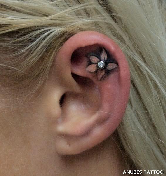 Ear Flower Tattoo with Piercing