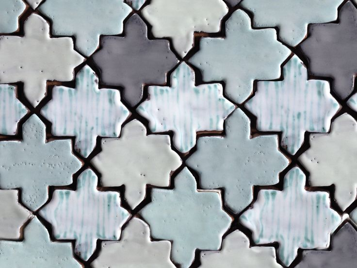 Handmade and painted ceramic tiles, arabesque pattern in pale shades of green, black - washed out tones