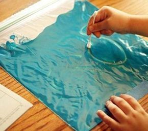 A freezer or zipper bag, acrylic paint and a cotton bud... The perfect tool to practise mark making and letter formation. Love it!