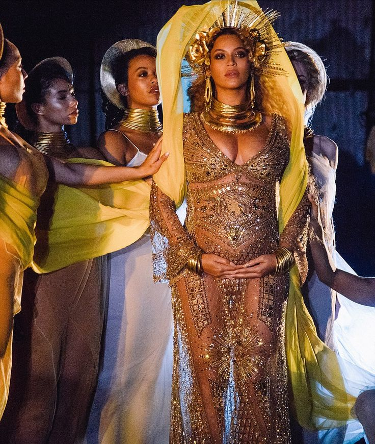 Sheer-ly amazing: The superstar wore a gold gown that showed some skin with its diaphanous material