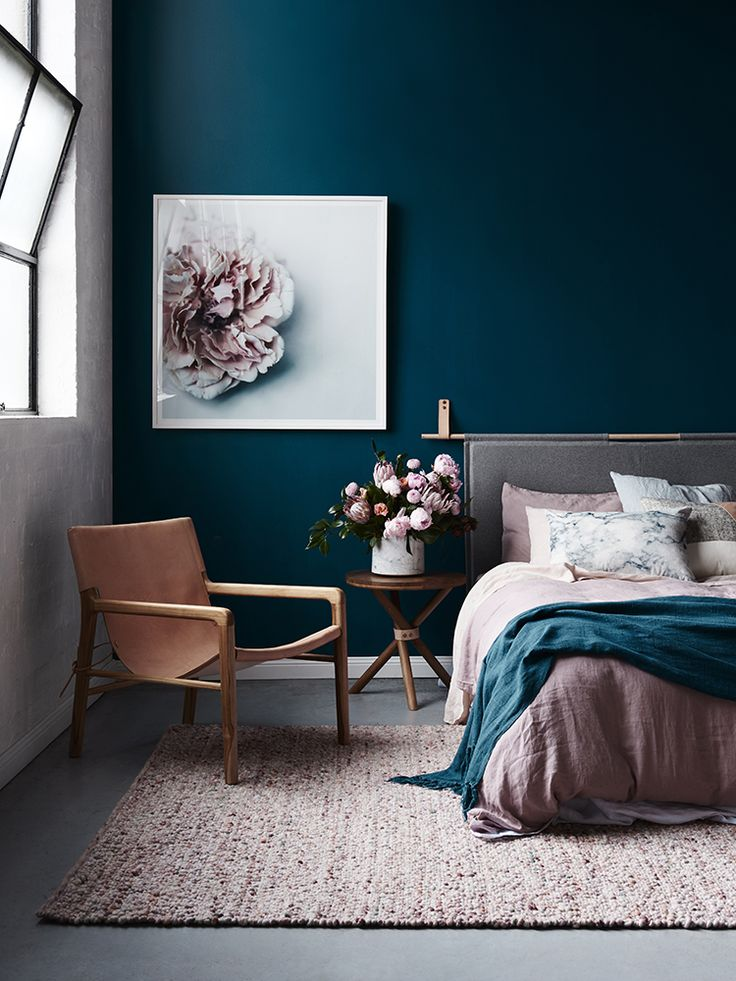 Gorgeous dark blue walls and blush accents. ** For everyone asking, the PAINT COLOUR IS GENTLEMAN'S GREY By BENJAMIN MOORE. **
