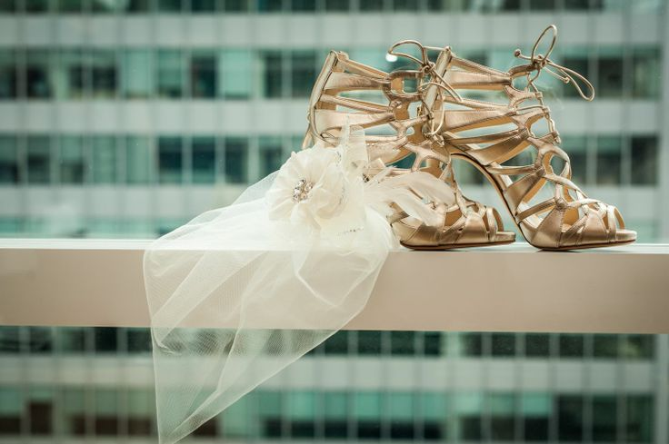 I love this shot of the bride's shoes and her headpiece !!