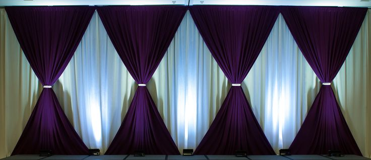 Simple drape for stage backdrop good use of up lights to for Backdrop decoration for church