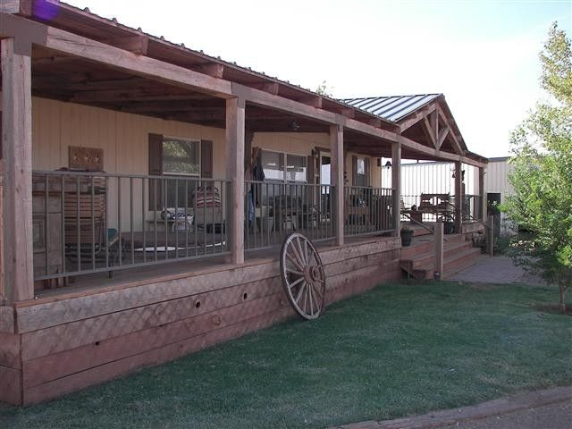 love the rustic porch on this new mexico horse ranch home