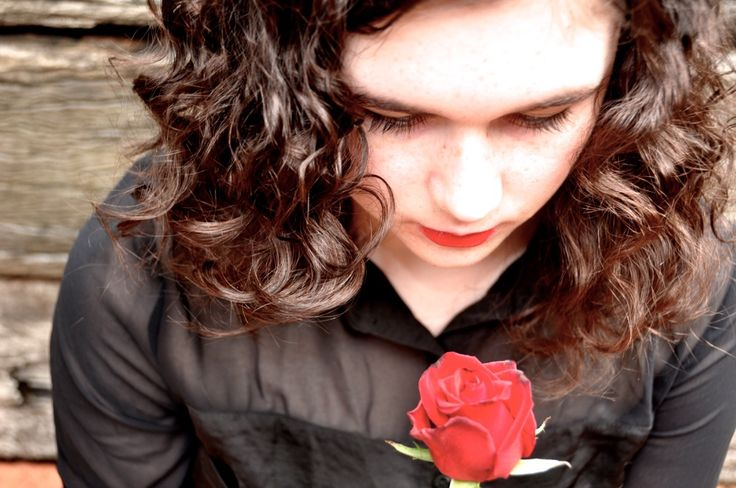 another picture of me with curly hair and a rose :P