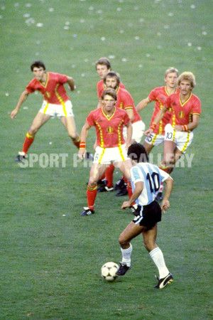 Diego Maradona of Argentina #10 is confronted by a posse of Belgium defenders during the match in the 1982 Wold Cup in Spain. \ Mandatory Credit: Steve Powell /Allsport