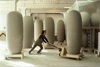 "Ceramic sculptor Jun Kaneko puts some muscle into moving one of his monumental Dango clay sculptures. Dango means ""dumpling"" or ""closed form"" in Japanese. Jun Kaneko moving one of his Dango sculptures on a cart, 1986 / unidentified photographer. Dorothy Weiss Gallery records, Archives of American Art, Smithsonian Institution."