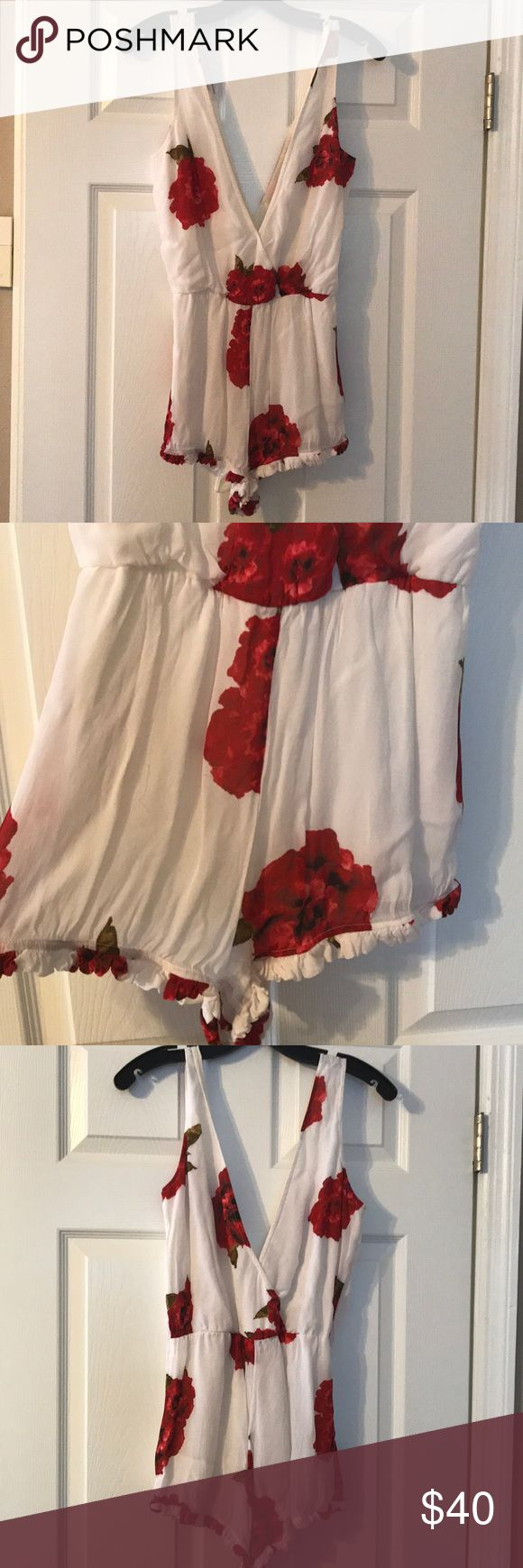 Floral Romper Winston White floral romper. Low v front and back. Ruffled bottom. Looks great with a leather jacket and booties. Size S. Worn twice. Perfect condition. winston white Pants Jumpsuits & Rompers