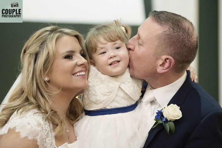 Enjoying kisses from mammy & daddy on the alter. Weddings at The Heritage Hotel by Couple Photography.