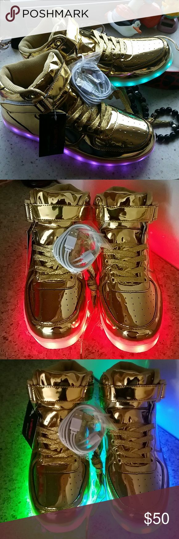 Versa Sport gold high top LED sneakers, Unisex Brand new LED light gold high tops. Comes with USB charger with two cords. Press button in charger port to switch colors, also does flashing lights. Shiny gold high top features cushioned ankle, gold laces, and velcro strap closure.  *Unisex, can fit size 8 guy or size 10 woman* versa sport Shoes Sneakers