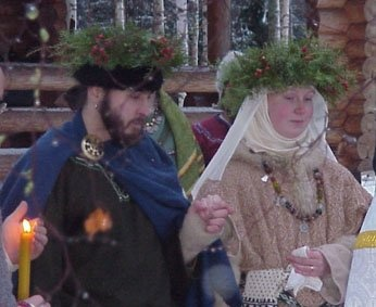 We got married in January 2002, in a very cold and snowy day. The ceremony was held outside, and the whole feast was organised by our friends in an little island in the middle of a lake... Novgorod-style costumes :)