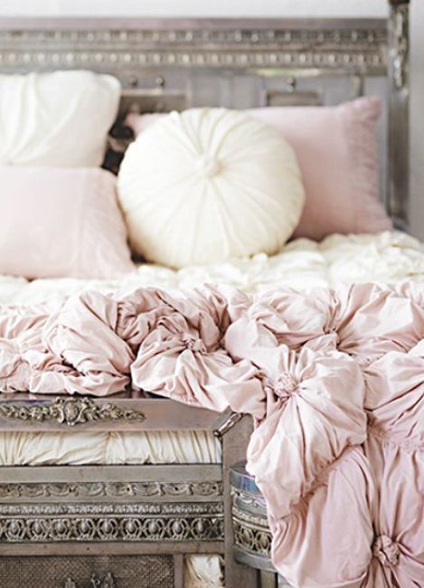 love this light pink bedding instead of just white. dreamy.