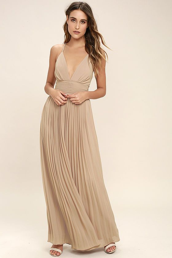Lulus Exclusive! Deeper than the deep blue sea and the Grand Canyon combined ... that's how deep our love for the Depths of My Love Nude Maxi Dress is! Elegant chiffon in a lovely neutral hue shapes a triangle bodice and sultry V-neckline supported by crisscrossing, adjustable spaghetti straps. The fitted, pintucked waistline accentuates your figure before flowing into an accordion pleated maxi skirt. Hidden back zipper and clasp.