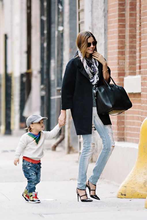 Miranda Kerr seen wearing ripped jeans and stiletto shoes while visiting the studio with baby Flynn in NYC