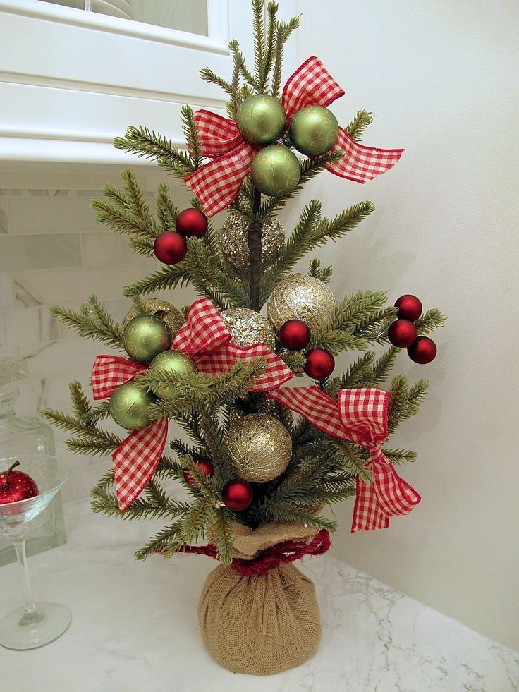 Tabletop Christmas Tree Accenting the Stairway Christmas