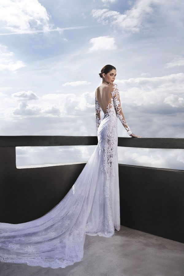 White long sleeved mermaid with Chantilly and Guipure lace , open back and transparent on the sides
