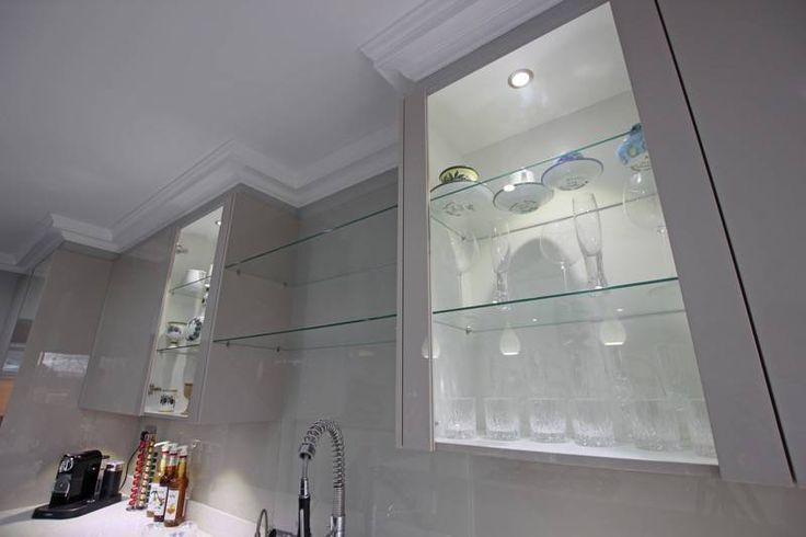 Cashmere gloss kitchen with glass accents
