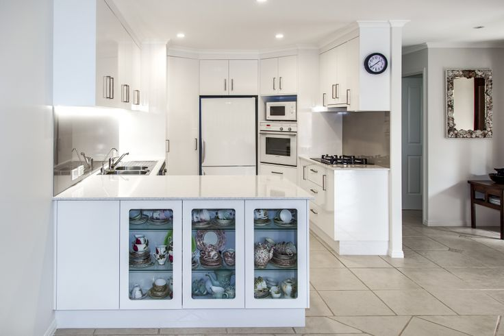 Entrant - The Cabinet House. Month - May. Products used - Cabinet doors – Formica Snowdrift gloss. Benchtop – essastone new basmati.