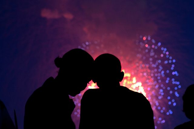 President Barack Obama and First Lady Michelle Obama watch the fireworks over the National Mall from the roof of the White House, July 4, 2010