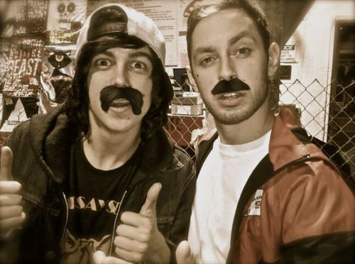 Kellin Quinn of SLeeping with sirens and Tyler Carter of issues wearing mustaches = awesomeness