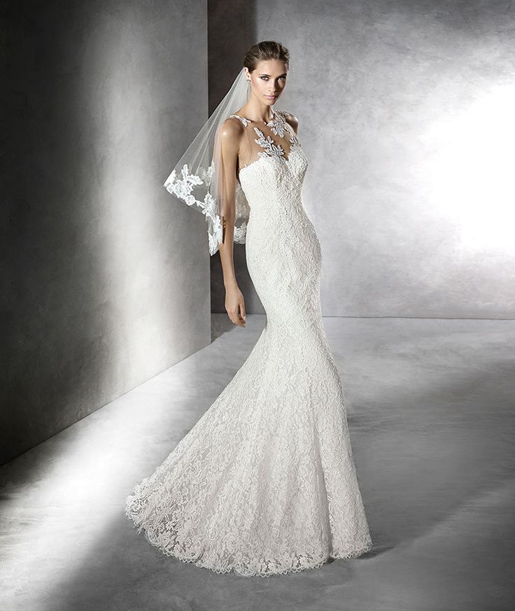 The New Design Wedding dress, lace mermaid dress. Bodice with sheer underbodice decorated with lace appliqus and sweetheart neckline. Sheer back with lace appliqus.  Free Measurement