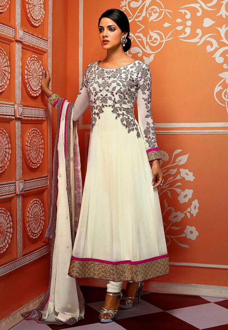 White and gold anarkali. Indian fashion.
