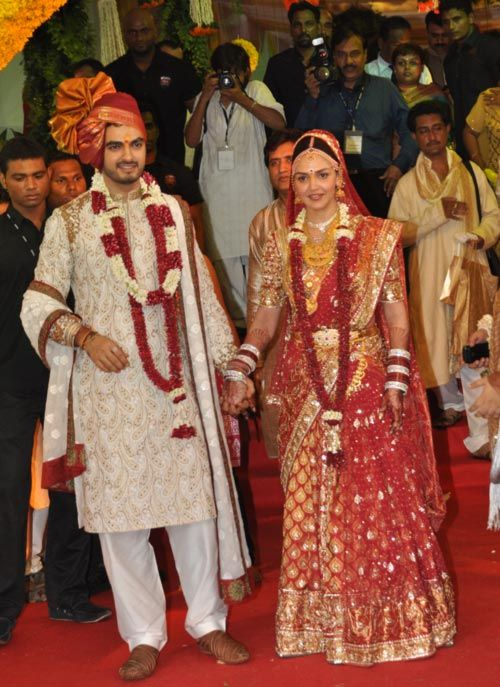 After a lavish sangeet ceremony, followed by the mehndi ceremony, veteran actors Hema Malini and Dharmendra's elder daughter Esha Deol got married to beau Bharat Takhtani in a traditional South Indian ceremony at Isckon temple in Juhu, a western Mumbai suburb, this morning.