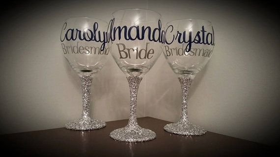 Simple, yet elegant wine glasses for all of yourself, your Bridesmaids, Personal Attendants, Mothers, etc! Let me personalize them by glittering the stem (with the glitter color of your choice), putting their name on the front of the glass (with the vinyl color of your choice), their title underneath (with the vinyl color of your choice) and tulle tied around the stem (with tulle color of your choice). These glasses are made of glass (not plastic) and hold roughly 20 oz of fluid. For the…