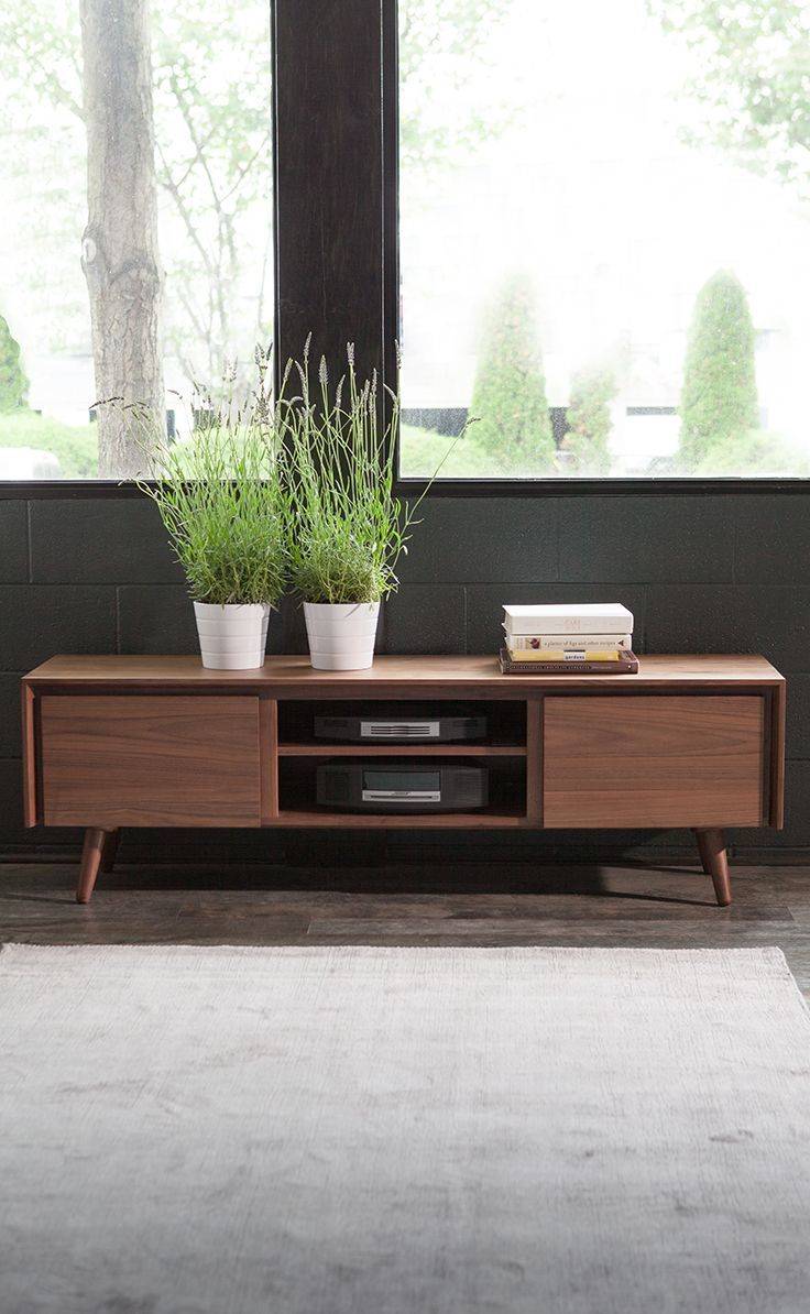 A mid-century modern media unit that can display and store all your entertainment items. Place a flatscreen on top, playback devices in the center storage and loose items like magazines, spare remotes, DVDs, and more in the two side cabinets.
