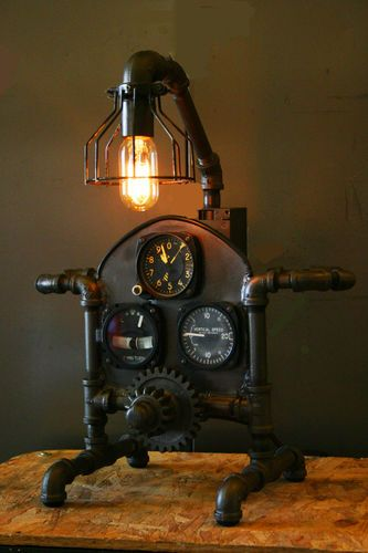 Steampunk aviation age lamp industrial light made with airplane instrument panel gauges.