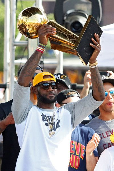 LeBron James Photos - LeBron James #23 of the Cleveland Cavaliers holds up the…