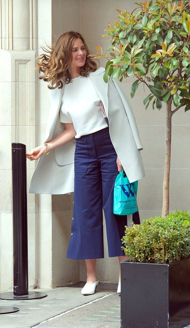 Elegant:Trinny Woodall and her partner Charles Saatchi still looked to be very much in love as they laughed and chatted when leaving their favourite restaurant Scott's in Mayfair on Saturday