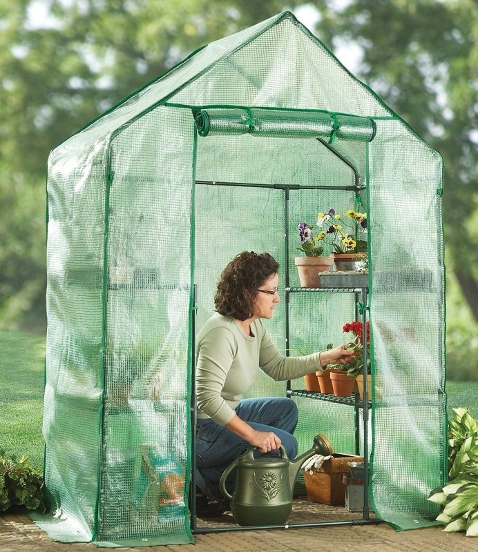 Compact Walk – in Greenhouse. Small enough to put on the side of the house.