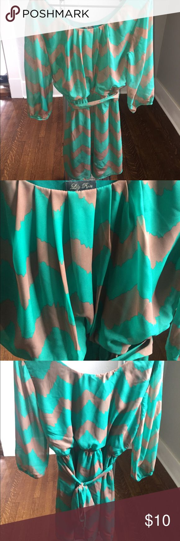 Lily Rose Turquoise and Tan Chevron Print Dress Lily Rose size medium turquoise and tan chevron print dress. Tie in back. Worn once. Stretchy waist. Lily Rose Dresses Long Sleeve