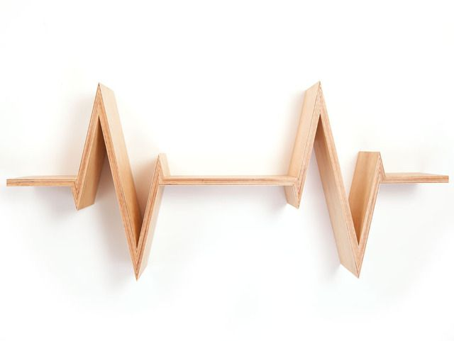 This shelf has the shape of a heartbeat and well... It brings your living room to life! Made out of European oak in Amsterdam.