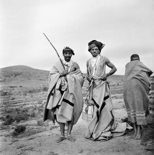 Two Xhosa men and a boy wrapped in blankets, Transkei, South Africa